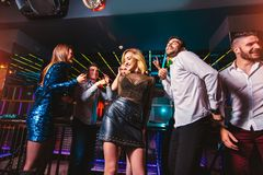 Happy people are dancing in club. Nightlife and disco concept stock photo