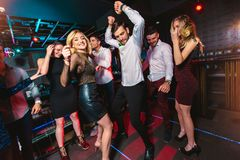 Happy people are dancing in club. Nightlife and disco concept stock photos