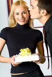 Young happy people with gift Stock Image