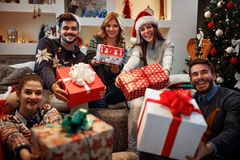 Young happy people with gifts for Christmas Royalty Free Stock Photos
