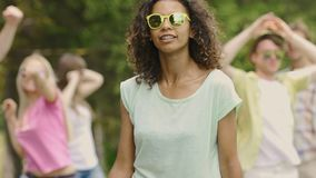 Young happy people shooting music video, actively dancing, smiling for camera. Stock footage stock video
