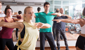 Young happy people studying zumba elements royalty free stock photography