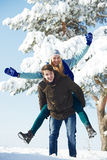 Young happy people walking in winter Stock Image