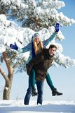 Young happy people in winter Stock Photos