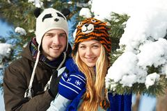 Young happy people in winter Royalty Free Stock Image