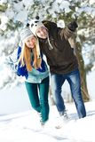Young happy people in winter Stock Images