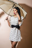 Young happy pinup style woman with umbrella Royalty Free Stock Photos