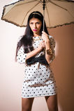 Young happy pinup style woman with umbrella Royalty Free Stock Images