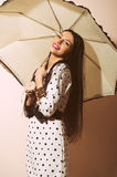 Young happy pinup style woman with umbrella Stock Image