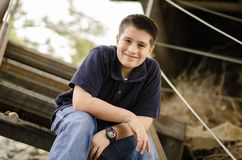 Young happy pre-teen posing at train trestle bridge. And stairs Stock Photography