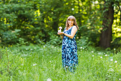 Young happy pregnant woman relaxing and enjoying life in nature. Outdoor shot. Copyspace Royalty Free Stock Photo