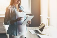 Young Happy Pregnant Woman Using Digital Tablet. Royalty Free Stock Photography