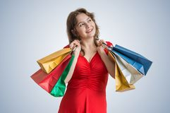 Young happy pretty woman holds many shopping bags in hands Stock Images