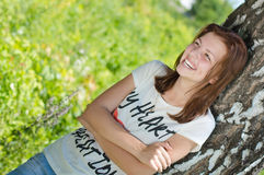 Young happy pretty woman laughing joyfully on summer day Stock Images