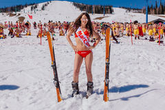 Young Happy Pretty Women On A Mountain Ski In Colorful Bikini. Royalty Free Stock Photos