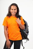 Young happy primary school girl with back pack Stock Photos