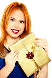 Young happy red haired woman with a gift box isolated Stock Photos