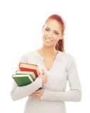 A young and happy redhead woman holding books Royalty Free Stock Photo