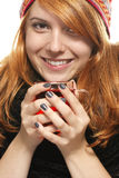 Young happy redhead woman in winter dress with tea Stock Images