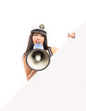 Young and happy sailor woman with a megaphone Royalty Free Stock Photos