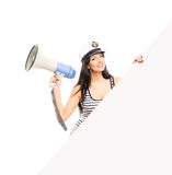 Young and happy sailor woman with a megaphone Royalty Free Stock Image