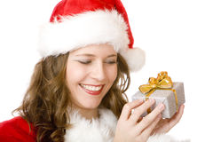 Young happy Santa Claus woman holds Christmas gift Stock Images