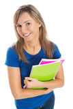 Young happy and satisfied student holding workbook. Stock Images