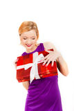 Young happy sexy party girl with big gift Royalty Free Stock Image