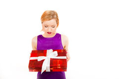 Young happy sexy party girl with big gift Stock Image
