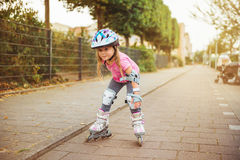 Young happy skater. Trying exciting outdoor activity royalty free stock images