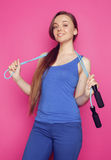 Young happy slim girl with skipping rope on pink Stock Images