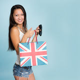 Young happy smiling Asian woman with shopping bag Stock Images