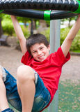 Young happy smiling boy playing at the park Royalty Free Stock Photos
