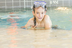 Young happy smiling boy in water pool Royalty Free Stock Photography