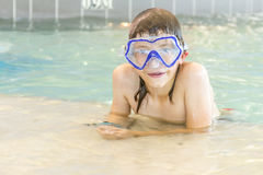 Young happy smiling boy in water pool Stock Image