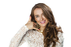 Young happy smiling brunette woman with call me gesture Royalty Free Stock Photo
