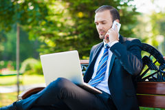 Young happy smiling business man working Royalty Free Stock Image