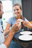 Young happy smiling couple eating cake Stock Photo
