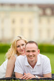 Young, happy and smiling couple lies on a grass Stock Image