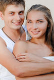 Young happy smiling couple on light background Royalty Free Stock Images