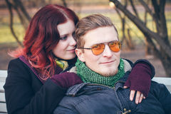 Young happy smiling couple in love. Have fun outdoor in cold autumn winter weather Stock Photos