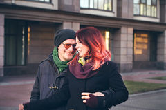 Young happy smiling couple in love. Have fun outdoor in cold autumn winter weather Royalty Free Stock Photos