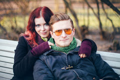 Young happy smiling couple in love. Have fun outdoor in cold autumn winter weather Royalty Free Stock Images