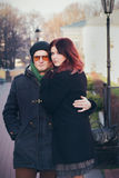 Young happy smiling couple in love. Have fun outdoor in cold autumn winter weather Stock Photography