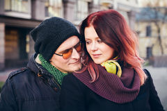 Young happy smiling couple in love. Have fun outdoor in cold autumn winter weather Royalty Free Stock Photography