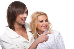 Young happy smiling couple pointing at something Royalty Free Stock Photography