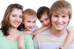 Young happy smiling family stock photos