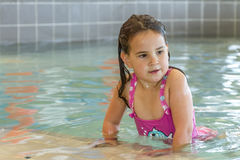 Young happy smiling girl in water pool Stock Photo