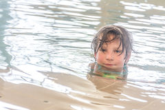 Young happy smiling girl in water pool Royalty Free Stock Photography