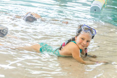 Young happy smiling girl in water pool Stock Images